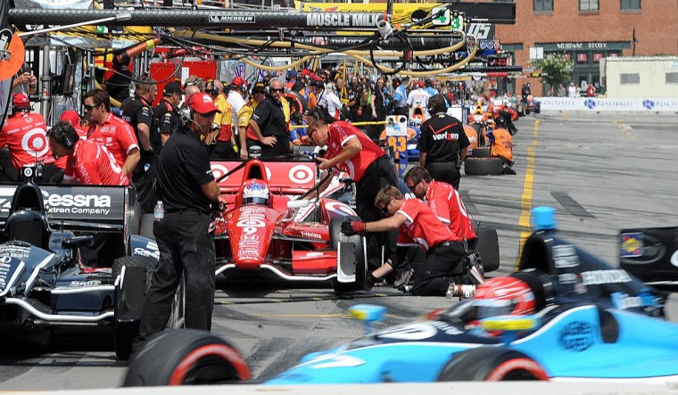 IndyCars are worked on in pit row at the start of a qualifying on Saturday. (Jerry Jackson/Baltimore Sun)