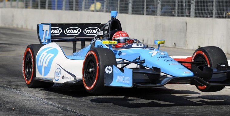 IZOD Indycar driver Simon Pagenaud's car #77 gets airborne after going over a chicane during the last practice before racing in the Grand Prix of Baltimore Sunday. (Kenneth K. Lam/Baltimore Sun)