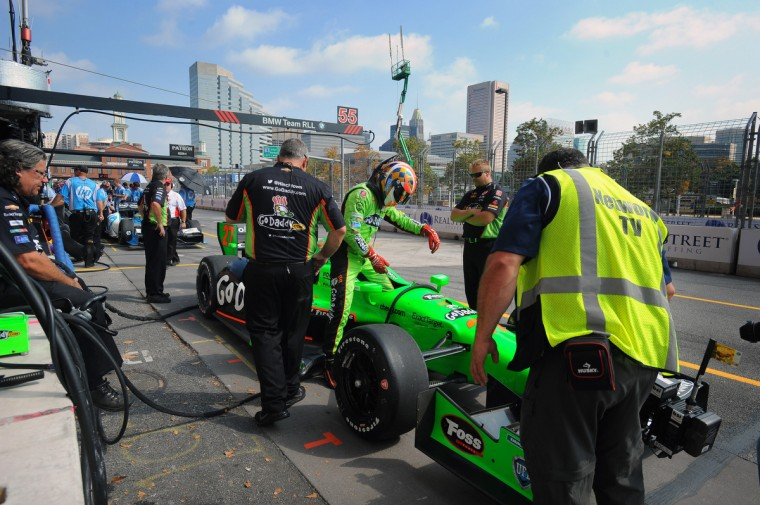IZOD Indycar driver James Hinchcliffe gets into the Go Daddy car at pit row to start a practice run during the Grand Prix of Baltimore. (Kenneth K. Lam/Baltimore Sun)