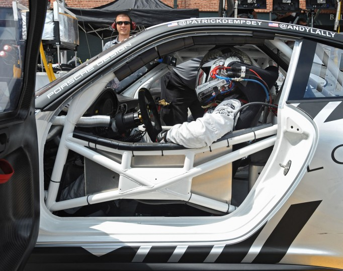 """Grey's Anatomy"" actor and racecar driver Patrick Dempsey gets into the driver's seat of a Porsche GT car during a practice run on the Grand Prix of Baltimore course on Friday. (Kenneth K. Lam/Baltimore Sun Photo)"