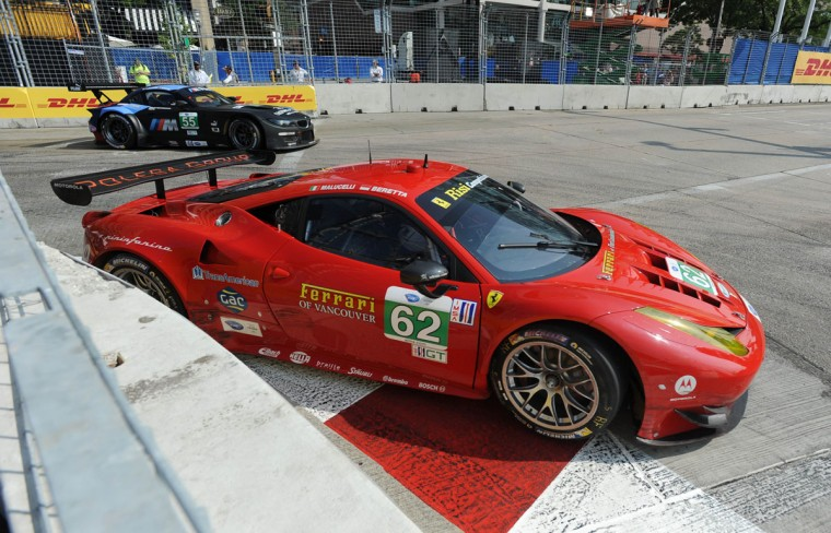 American Le Mans Series cars navigate turn one during Saturday morning warm-ups. (Jerry Jackson/Baltimore Sun Photo)