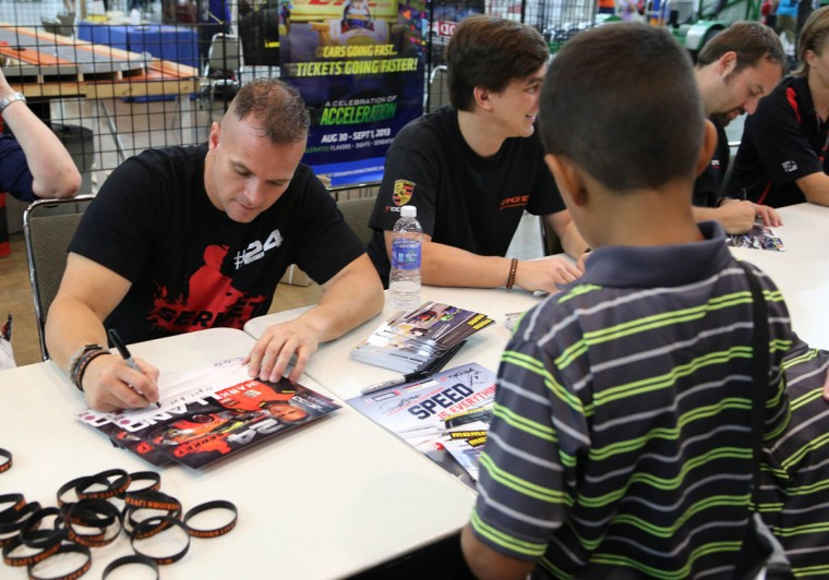 Alex Barham of Aberdeen, Md., gets an autograph from American Le Mans Series driver Mark Llano of NGT Motorsport at the Grand Prix of Baltimore. (Kaitlin Newman/Baltimore Sun Photo)