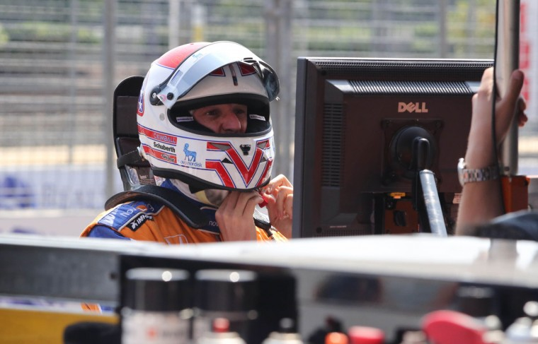 IndyCar driver Charlie Kimball adjusts his helmet on the second day of the 2013 Grand Prix of Baltimore. (Kaitlin Newman/Baltimore Sun Photo)