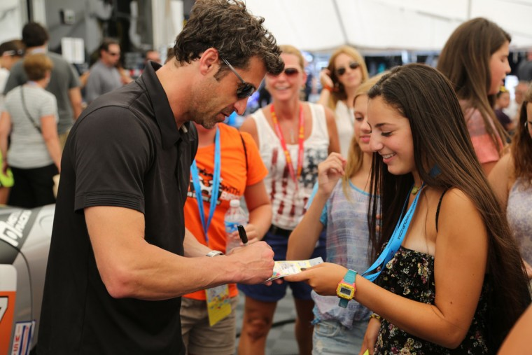 """Grey's Anatomy"" star at American Le Mans Series driver Patrick Dempsey signs an autograph for Sarah Steinberg, a 15-year-old from Baltimore. (Kaitlin Newman/Baltimore Sun Photo)"