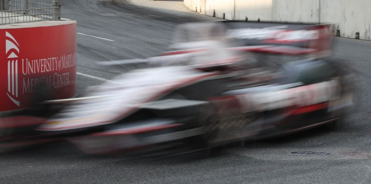Will Power is a blur making the turn onto Pratt Street during Saturday morning's IndyCar practice session at the Grand Prix of Baltimore. (Kaitlin Newman/Baltimore Sun Photo)