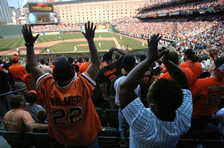 In the crowd: Fans cheer Brian Roberts' fifth-inning home run on Opening Day at Oriole Park at Camden Yards on April 4, 2011. (Jerry Jackson/Baltimore Sun Photo)