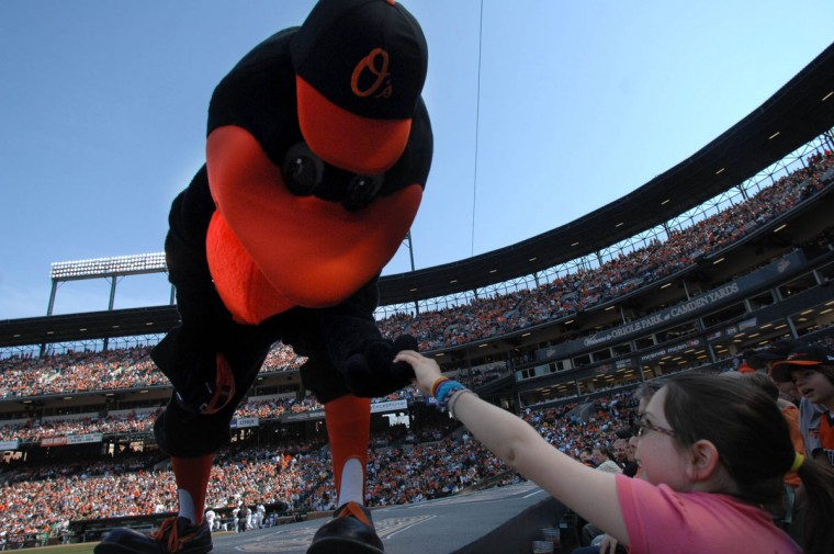 From the dugout: Shelby Snyder, 9, shakes hands with the Oriole Bird behind the third base dugout at Oriole Park at Camden Yards on April 4, 2011. (Jerry Jackson/Baltimore Sun Photo)