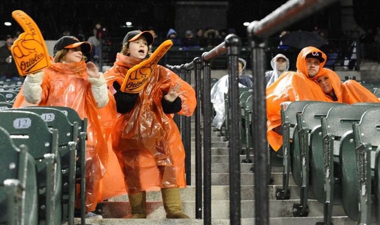 In the stands: Kailey Wimer (from left), her best friend Sam Herold, Matt Morris, his friend Gretchen Higgs, and other Orioles fans wait for the start of the Orioles game during a rain delay in April 2011. The game was Wimer and Herold's first ever Orioles game. (Kenneth K. Lam/Baltimore Sun Photo)