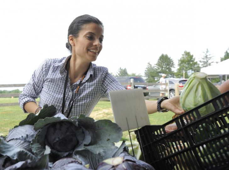 Jenny Perez examines cabbage at a farmers' market at Boordy Vineyards in Hydes. (Lloyd Fox/Baltimore Sun Photo)