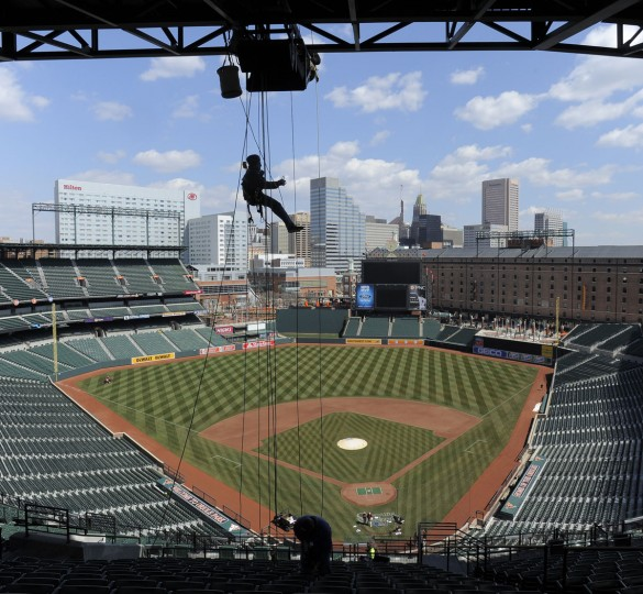 When it's empty: Josh Marrits of Washington Professional Systems rappels down from the roof of Camden Yards while fixing broken speakers around the stadium. (Lloyd Fox/Baltimore Sun Photo)