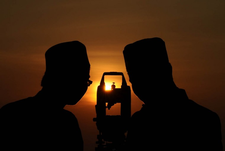 Indonesian Muslims hold a Rukyatul Hilal to see the new crescent moon that determines the end of Ramadan at Condro Dipo Hill in Gresik, Indonesia. There have been confirmed sightings of the new moon, which ends the holy month of Ramadan with the Muslim holiday Eid al-Fitr. (Robertus Pudyanto/Getty Images)