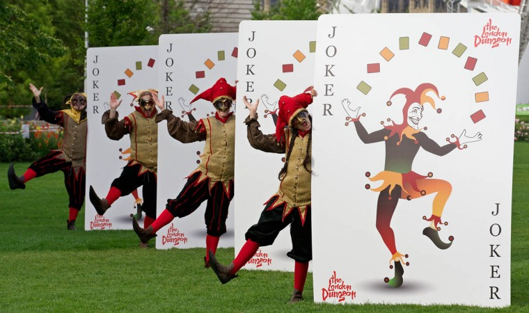'Black Jesters' from the London Dungeon pose for pictures with a set of what the attraction describes as the world's biggest playing cards, during a photocall in London. The cards, which are 2.1m tall and 1.5m wide, will feature in the attraction's 'Jestival Season'. (Andrew Cowie/Getty Images)