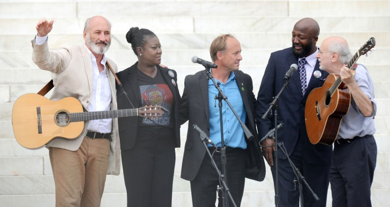 "Singers Peter Yarrow and Paul Stookey sing alongside with Trayvon Martin's parents, Tracy Martin and Sybrina Fulton, during the ""Let Freedom Ring"" ceremony to commemorate the 50th anniversary of the March on Washington for Jobs and Freedom at the Lincoln Memorial on the National Mall on August 28, 2013 in Washington, DC. (Olivier Douliery/Abaca Press/MCT)"