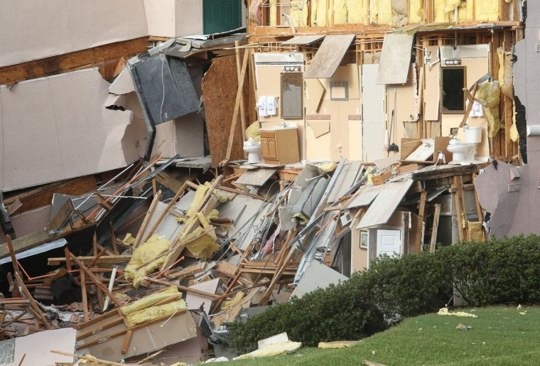 Buildings collapse into a sinkhole at the Summer Bay Resort on U.S. Highway 192 in Clermont, Florida, Monday, August 12, 2013. No one was injured but about three dozen resort goers left behind car keys, medication and other personal belongings inside their luxury condominiums after the crumbling edifices were evacuated. (Red Huber/ Orlando Sentinel/MCT)