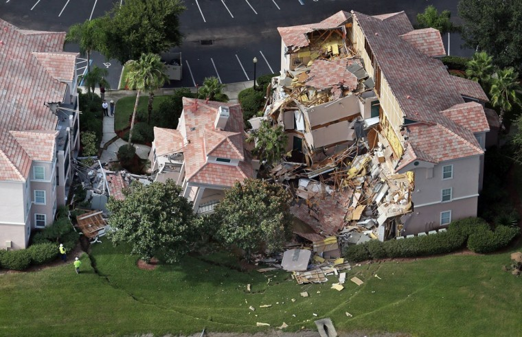 Buildings collapse into a sinkhole at the Summer Bay Resort on U.S. Highway 192 in Clermont, Florida, Monday, August 12, 2013. Guests had only 10 to 15 minutes to escape the collapsing buildings at the Summer Bay Resort on U.S. Highway 192 in the Four Corners area, located about 7 miles east of Walt Disney World resort, where a large sinkhole- about 60 feet in diameter and 15 feet deep- opened in the earth late Sunday. (Red Huber/Orlando Sentinel/MCT)