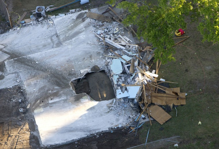 An aerial view of a sinkhole at 240 Faithway Drive in Seffner, Florida that opened up, killing Jeffrey Bush is seen March 4, 2013. The sinkhole is exposed as demolition of the house continues. (Dirk Shadd/Tampa Bay Times/MCT)