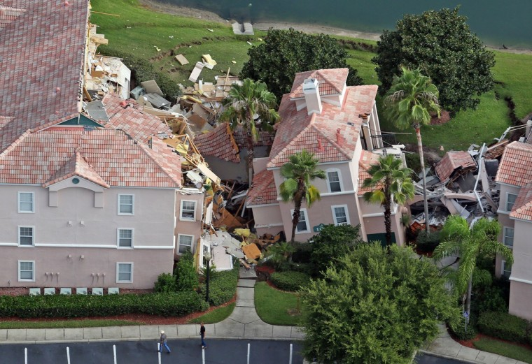 Guests had only 10 to 15 minutes to escape the collapsing buildings at the Summer Bay Resort on U.S. Highway 192 in the Four Corners area, see Monday, August 12, 2012, located about 7 miles east of Walt Disney World resort, where a large sinkhole - about 60 feet in diameter and 15 feet deep - opened in the earth late Sunday, August 11. (Red Huber/Orlando Sentinel/MCT)