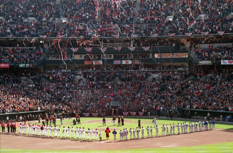 From the cheap seats: The Orioles and the Royals line up on the baselines during the National Anthem on Opening Day at Oriole Park at Camden Yards on April 2, 1996. (Kim Hairston/Baltimore Sun Photo)