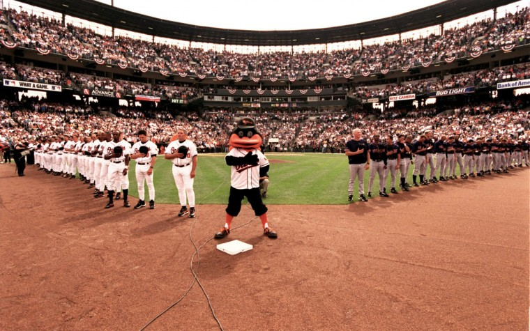 From the field: The Oriole Bird, the Orioles and the Indians stand on the field during the National Anthem on Opening Day at Oriole Park at Camden Yard, April 3, 2000. (Gene Sweeney Jr./Baltimore Sun Photo)