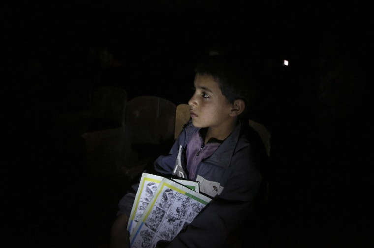 A boy watches a documentary, about the history of circus acts in Afghanistan, at the Mobile Mini Circus For Children in Kabul. (Omar Sobhani/Reuters photo)