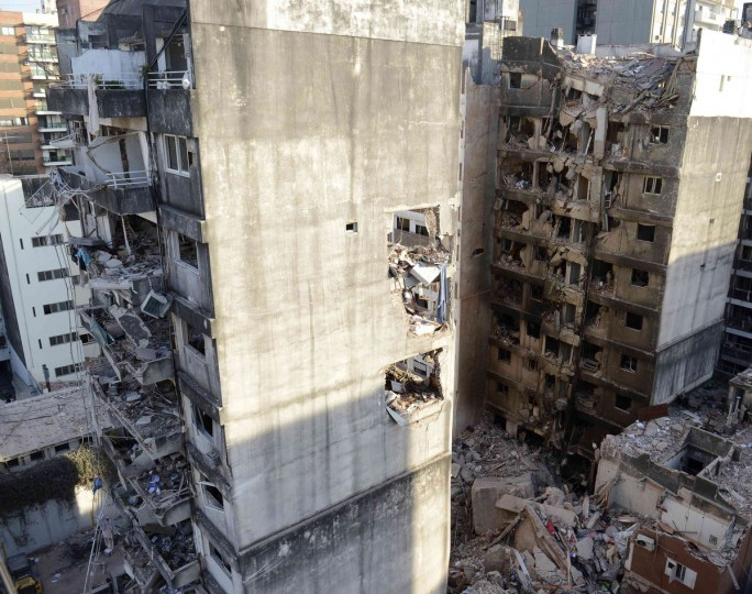Destroyed apartments are seen after an explosion believed to be caused by a gas leak, which tore through a 10-story building in Rosario city, in the province of Santa Fe. Local authorities have confirmed 12 people remain missing after a building collapsed yesterday killing at least 10 people and leaving more than 60 injured. (Federico Fernandez/Reuters)