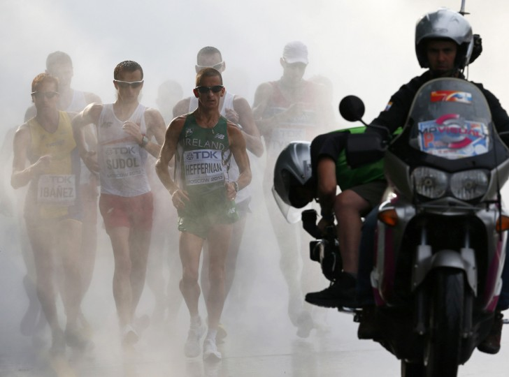 Robert Heffernan of Ireland (C) comes out of the cooling mist in the men's 50 km race walk final during the IAAF World Athletics Championships in Moscow. (Denis Balibouse/Reuters)