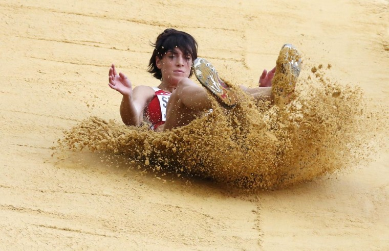 Ivana Spanovic of Serbia competes in the women's long jump final during the IAAF World Athletics Championships at the Luzhniki stadium in Moscow August 11, 2013. (Maxim Shemetov /Reuters)