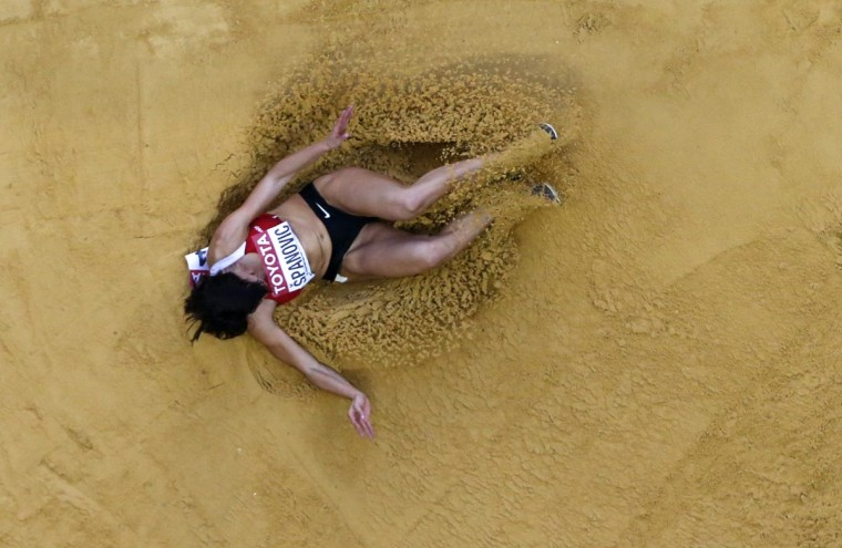 Ivana Spanovic of Serbia competes during the women's long jump final at the IAAF World Athletics Championships at the Luzhniki stadium in Moscow August 11, 2013. (Pawel Kopczynski/Reuters)