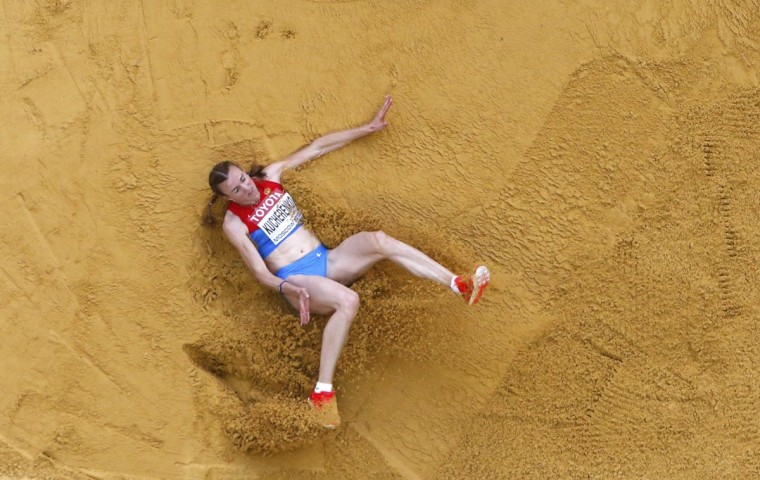 Olga Kucherenko of Russia competes during the women's long jump final at the IAAF World Athletics Championships at the Luzhniki stadium in Moscow August 11, 2013. (Pawel Kopczynski/Reuters)