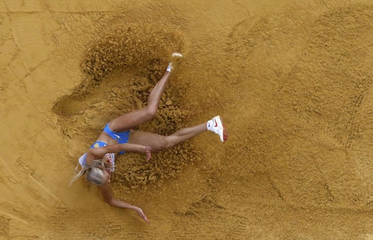 Darya Klishina of Russia competes during the women's long jump final at the IAAF World Athletics Championships at the Luzhniki stadium in Moscow August 11, 2013. (Pawel Kopczynski/Reuters)