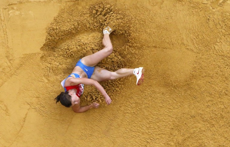 Elena Sokolova of Russia competes during the women's long jump final at the IAAF World Athletics Championships at the Luzhniki stadium in Moscow August 11, 2013. (Pawel Kopczynski/Reuters)