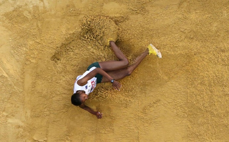 Chantel Malone of the British Virgin Islands competes in the women's long jump qualifying round during the IAAF World Athletics Championships at the Luzhniki stadium in Moscow August 10, 2013. (Fabrizio Bensch/Reuters)