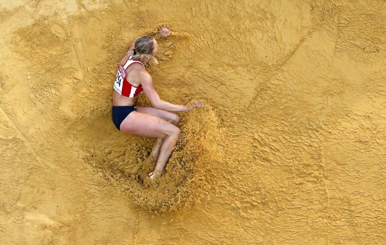 Jana Koresova of the Czech Republic competes in the women's long jump qualifying round during the IAAF World Athletics Championships at the Luzhniki stadium in Moscow August 10, 2013. (Fabrizio Bensch/Reuters)