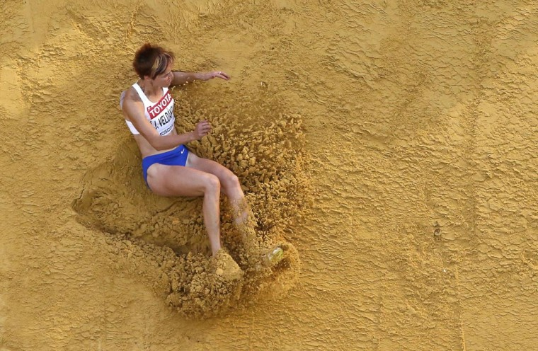 Jana Veldakova of Slovakia competes in the women's long jump qualifying round during the IAAF World Athletics Championships at the Luzhniki stadium in Moscow August 10, 2013. (Fabrizio Bensch/Reuters)