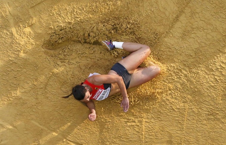 Lena Malkus of Germany competes in the women's long jump qualifying round during the IAAF World Athletics Championships at the Luzhniki stadium in Moscow August 10, 2013. (Fabrizio Bensch/Reuters)