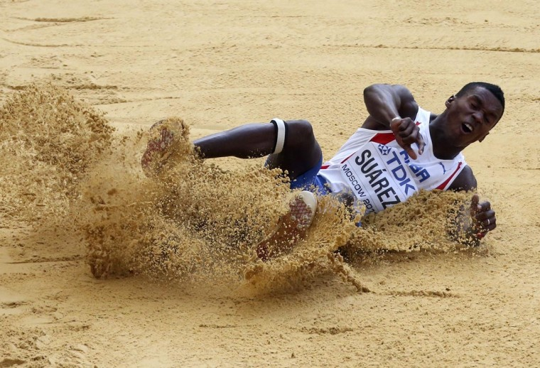 Suarez of Cuba competes in men's decathlon long jump event at World Athletics Championships in Moscow