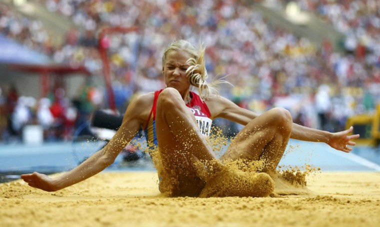 Darya Klishina of Russia competes during the women's long jump final at the IAAF World Athletics Championships at the Luzhniki stadium in Moscow August 11, 2013. (Dominic Ebenbichler/Reuters)