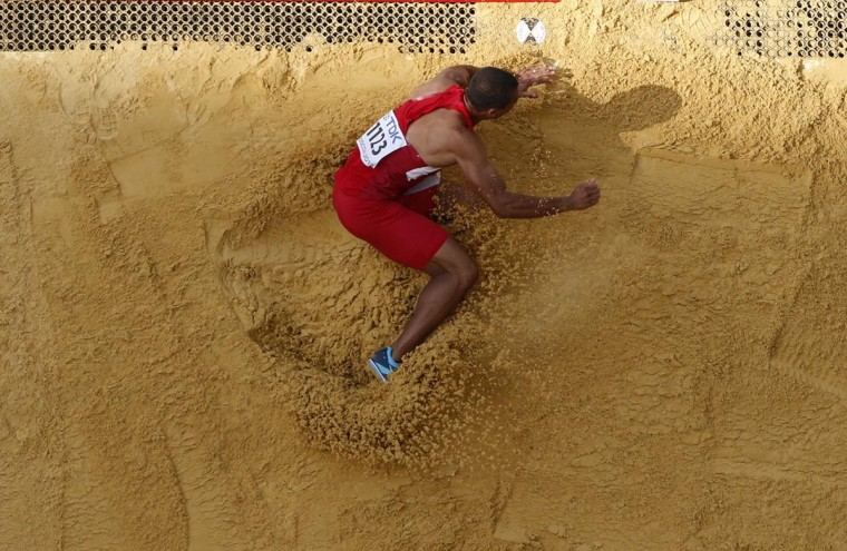 Ashton Eaton of the U.S. competes in the men's decathlon long jump event at the IAAF World Athletics Championships at the Luzhniki stadium in Moscow August 10, 2013. (Fabrizio Bensch/Reuters)