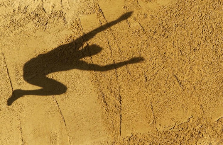 Rico Freimuth of Germany casts a shadow on the sand as he competes in the men's decathlon long jump event at the IAAF World Athletics Championships at the Luzhniki stadium in Moscow August 10, 2013. (Fabrizio Bensch/Reuters)