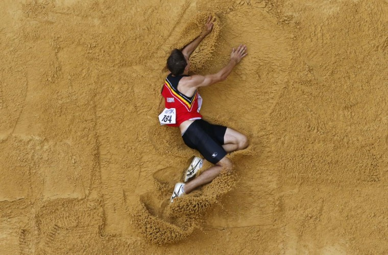 Thomas van der Plaetsen of Belgium competes in the men's decathlon long jump event at the IAAF World Athletics Championships at the Luzhniki stadium in Moscow August 10, 2013. (Fabrizio Bensch/Reuters)