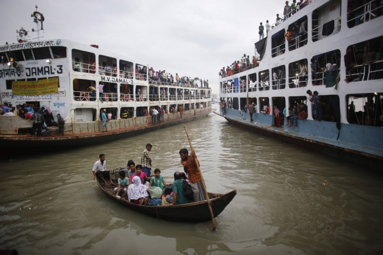 People are rowed to an overcrowded passenger boat at Sadarghat boat terminal in Dhaka. Millions of residents in Dhaka have started the exodus home from the capital city ahead of the Eid al-Fitr holiday, which marks the end of the fasting month of Ramadan. (Andrew Biraj/Reuters)