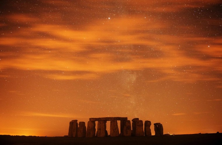 A general view of Stonehenge during the annual Perseid meteor shower in the night sky in Salisbury Plain, southern England August 13, 2013. The Perseid meteor shower is sparked every August when the Earth passes through a stream of space debris left by comet Swift-Tuttle. Picture taken using a long exposure. (Kieran Doherty/Reuters)