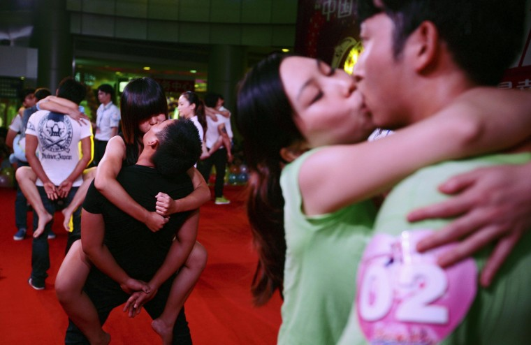Couples compete in a kissing competition at a shopping mall on the Qixi Festival in Quanzhou, Fujian province. Qixi, also known as the Double Seventh Festival and the Chinese version of Valentine's Day, falls on the seventh day of the seventh month in the Chinese lunar calendar. Over a hundred couples attended this competition on Tuesday evening which required them to kiss in different postures for as long as possible, local media reported. (Reuters)