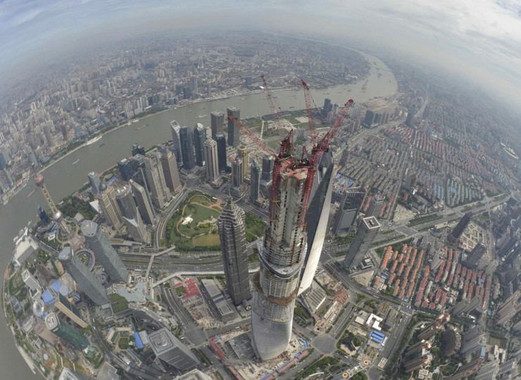 A general view of the financial district of Pudong with the Shanghai Tower (C), which is undergoing construction scheduled to finish by the end of 2014, in Shanghai August 3, 2013. The 2,073-ft high Shanghai Tower will be the tallest skyscraper in China and the second tallest in the world. Picture taken August 3, 2013. (Shanghai Tower/Handout via Reuters)