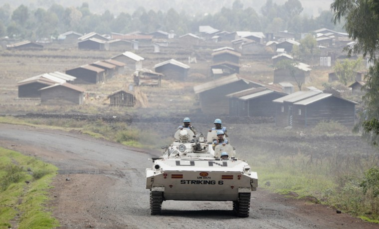 U.N. peacekeepers patrol in their tank, past the deserted Kibati village, near Goma in the eastern Democratic Republic of Congo. A 17,000-strong U.N. force, known as MONUSCO, and Congo troops have struggled over the past decade to stem a conflict involving dozens of armed groups and complicated by national and ethnic rivalries. A new 3,000-member U.N. Intervention Brigade was recently deployed to fight and disarm rebels in the east. (Thomas Mukoya/Reuters)