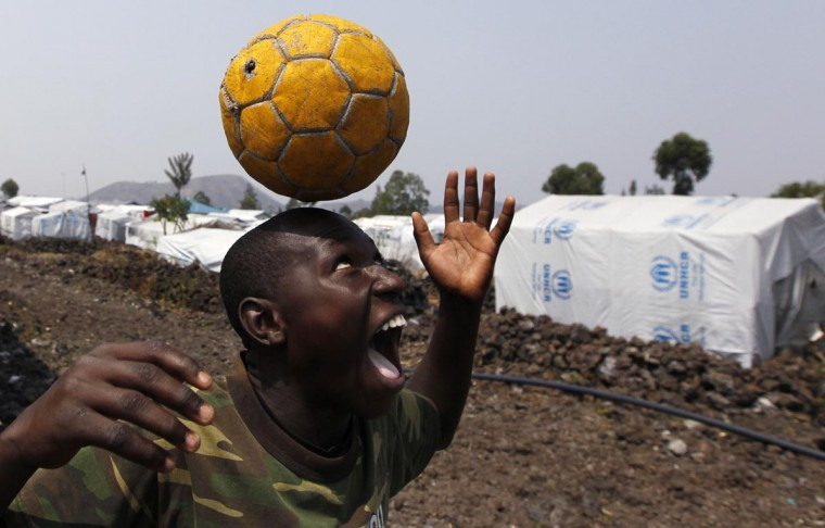 A Congolese boy displaced by recent fighting in North Kivu, juggles a ball near his makeshift shelter at the Mugunga III camp for internally displaced people near Goma, eastern Democratic Republic of Congo, August 4, 2013. A 17,000-strong U.N. force, known as MONUSCO, and Congo troops have struggled over the past decade to stem a conflict involving dozens of armed groups and complicated by national and ethnic rivalries. (Thomas Mukoya/Reuters)