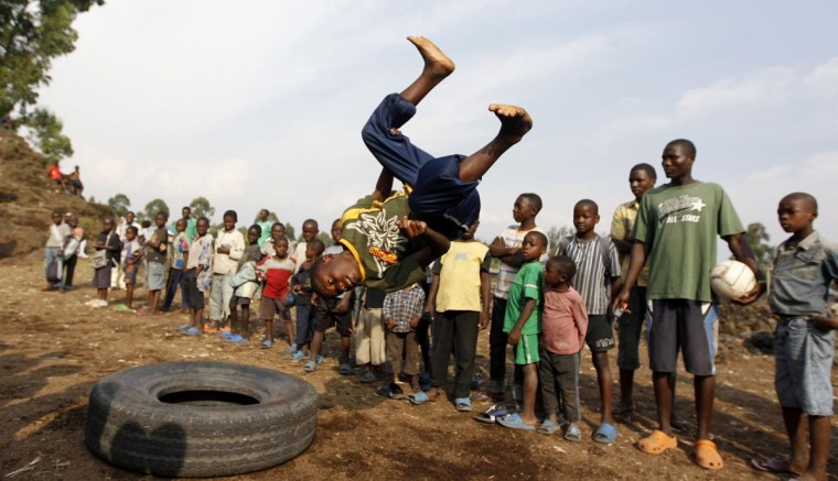 A youth jumps through the air as he plays at the Don Bosco Ngangi community center in Goma, North Kivu region, August 6, 2013. The center was established in 1988 and hosts over 3,000 abandoned children and HIV/AIDS victims. Recently, they have been receiving victims from the fighting between the Congolese army known as the FARDC and the M23 rebels in North Kivu province, according to an official from the center. (Thomas Mukoya/Reuters)