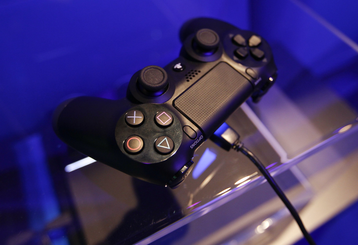 Modern Exhibition Stand Xbox One : A controller of playstation is pictured at the sony