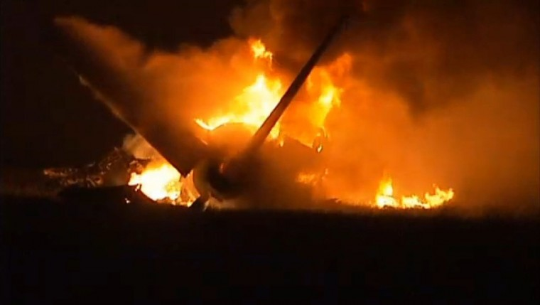 Flames rise from a UPS Airbus A300 cargo plane which crashed near the airport in Birmingham, Alabama in this still image from video courtesy of TV station Alabama's 13. A large UPS cargo plane crashed early Wednesday morning near the airport in Birmingham, Alabama, killing the pilot and co-pilot, in the latest in a series of aviation accidents in the United States this year. (Alabama's 13/Handout via Reuters)