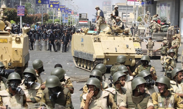 Riot police and army personnel take them up positions during clashes with members of the Muslim Brotherhood and supporters of ousted Egyptian President Mohamed Mursi around the area of Rabaa Adawiya square, where they are camping, in Cairo August 14, 2013. (Asmaa Waguih/Reuters)